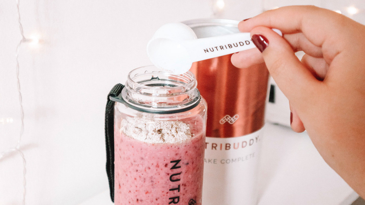 Berry meal replacement shake for weight loss with straw